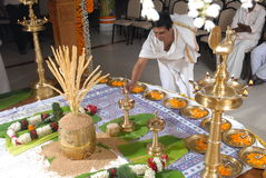 A kerala wedding flower decoration. 10 SEP 2010 GURUVAYUR KERALA INDIA - a priest lighting the kuthu vilakku on a kerala hindu malayalee wedding stage decoration stock images