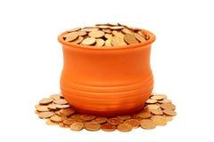 Keramischer Potenziometer mit Münzen. Lizenzfreies Stockfoto