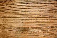Keramischer Topfoberflächen-Nahaufnahmehintergrund Roter Lehm zeichnet raue Beschaffenheit Stockbilder