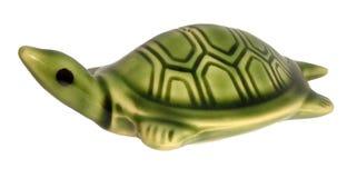 Keramisk statyett för grön sköldpadda royaltyfri foto