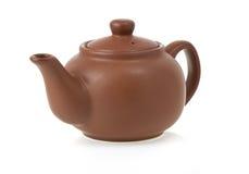 Keramisk teapot på vit Fotografering för Bildbyråer