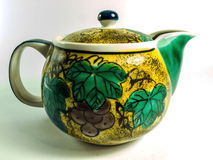 Keramisk teapot på vitbakgrund Royaltyfri Fotografi