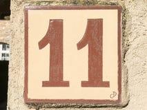Keramisk tegelplatta med nummer elva 11 Arkivbild