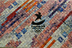 Keramisk vägg med Singapore OSlogo Arkivbilder