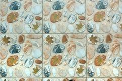 Keramiska tegelplattor för dekorativt golv med kiselstentextur arkivbild