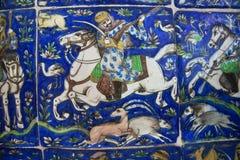 Keramiska tegelplattor för tappning av det 19th århundradet med jaktplats och en hästryttare Arkivbilder