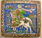 Keramiska tegelplattor för tappning från Persien det 19th århundradet med bilden av en krigare på hästrygg Arkivbilder