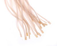 Keratin capsules of blonde hair extensions. Isolated on white Royalty Free Stock Photo
