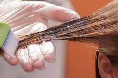 Keratin hair straightening at home. Keratin hair straightening close-up Royalty Free Stock Photos