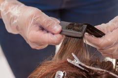 Keratin hair straightening at home. Keratin hair straightening close-up Royalty Free Stock Photography