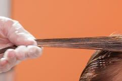 Keratin hair straightening at home. Keratin hair straightening close-up Royalty Free Stock Photo