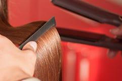 Keratin hair straightening at home. Keratin hair straightening close-up Stock Images