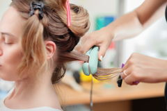 Keratin hair straightening at home. Two girls make keratin straightening hair at home Stock Images