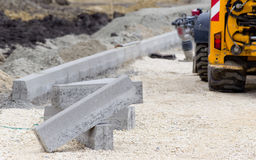 Kerbs at road construction site Stock Photo