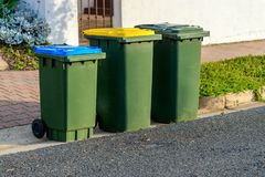 Kerbside bins ready for collection. Kerbe waste bins ready for collection by local council in Australian suburb Royalty Free Stock Image
