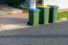 Kerbside bins ready for collection. Kerbe waste bins ready for collection by local council in Australian suburb Stock Photography