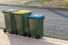 Kerbside bins ready for collection. Kerbside waste bins ready for collection by local council in Australian suburb Stock Photo