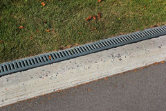 Kerbside and rainwater drainage system in a park Royalty Free Stock Photography