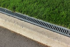 Kerbside and rainwater drainage system in a park Royalty Free Stock Images