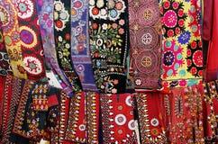 Kerchiefs and woman's wear. Turkmenistan. Ashkhabad market Royalty Free Stock Photography