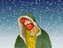 In kerel in de kap in de sneeuw Stock Afbeelding