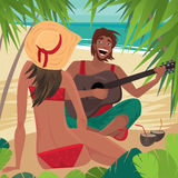 Kerel die de gitaar voor een meisje op het strand spelen Stock Foto