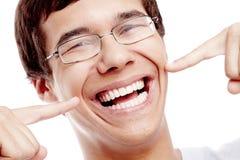 Kerel die zijn gezonde glimlach tonen royalty-vrije stock foto