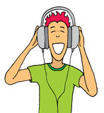 Kerel het luisteren muziek op reusachtige hoofdtelefoons Stock Foto's