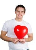 Kerel met een rood hart Royalty-vrije Stock Afbeelding