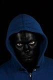 Kerel met zwart geschilderd gezicht Stock Foto