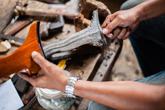 Keris Making. Keris is a Malay traditional weapon, now is used as accessory for some formal function such as Malay traditional wedding ceremony Stock Photos