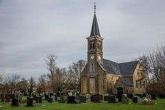 Kerk en Begraafplaats in Holland stock foto