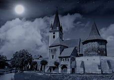Kerk onder volle maan en sterren Stock Fotografie