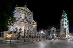 Kerk van St Peter en Paul tijdens de nacht in Krakau, Stock Foto