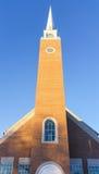 Kerkspits met blauwe hemel Stock Afbeelding