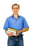 Kerl mit einem Stapel der Bücher. Getrennt auf Weiß. Stockfotografie