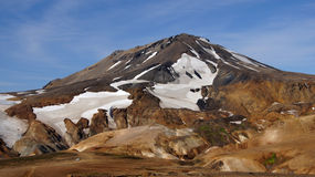 Kerlingarfjöll mountain and car. Kerlingarfjöll panorama of mountains with a little car parking in summer in Iceland stock photo