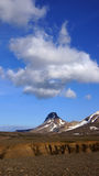 Kerlingarfjoll mountain and cloud. Kerlingarfjöll panorama picture of great cloud above chocolate coloured mountains in summer in Iceland stock photo
