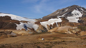 Kerlingarfjöll mountain and motorhome. Kerlingarfjöll panorama of mountains with a little motorhome driving to the parking in summer in Iceland royalty free stock images