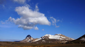 Kerlingarfjoll mountains and clouds. Kerlingarfjöll panorama picture of great clouds above chocolate coloured mountains in summer in Iceland royalty free stock image