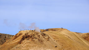 Kerlingarfjöll people on mountain. Kerlingarfjöll panorama picture of people high on mountain top where hot steam is bursting out in summer in Iceland stock photography