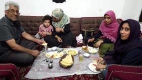 Kerman, Iran - 2019-04-06 - Iranian Family Has Dinner in Restaurant stock footage