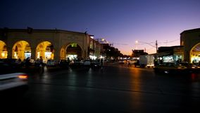 Busy square in old town of Kerman, Iran. KERMAN, IRAN - OCTOBER 15, 2017: Heavy traffic in Shohada square with a view on pavilions of Ganjali Khan Bazaar in stock video footage