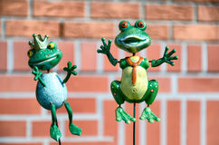 Kermett the Frog and his princess on a skewer. Kermett similar frog sculpture that Dominating with his princess in the garden outside the building. Green frogs Royalty Free Stock Photo