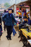 The tailor at mountainous district market Stock Photography