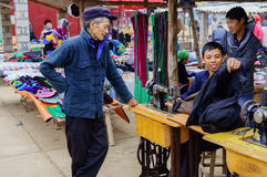 The tailor at mountainous distric market Stock Image