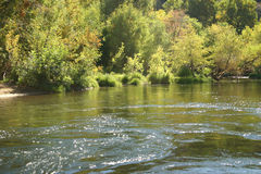 Kern river, Ca. in late summer. The Kern River in late summer plays host to fly fishing, river rafting and lazy summer days of swimming Royalty Free Stock Photography