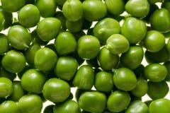 Kerne der grünen Erbsen Stockfoto