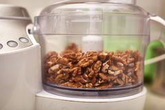 Kernel walnuts in a food processor Stock Photography