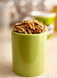 Kernel walnuts in a green cup Stock Images